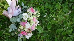 Bridal bouquet lying on the grass  Stock Footage