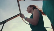 Young girl in turquoise dress drive motor boat with man. Evening. Romantic Stock Footage