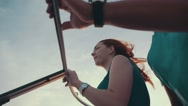 Red hair girl in turquoise dress drive motor boat with man. Sunset. Romantic Stock Footage