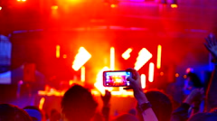 4K Stable View of Mobile Phone Held in Crowd, Live Music Festival, Happy People Stock Footage
