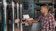 Handsome Man In Pub Drinking Beer Degustating different beers. Stout Ale and Stock Footage