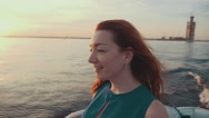 Red hair girl in dress on motor boat. Beautiful summer sunset. Entertainment Stock Footage