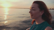 Red hair happy girl in dress on motor boat. Beautiful sunset. Entertainment Stock Footage