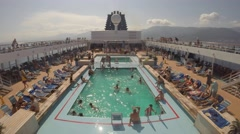 Time lapse of Mediterranean cruise ship pool deck as it leaves Corsica, France Stock Footage