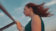 Young red hair girl on motor boat. Summer windy evening. Sunset. Blue sky Stock Footage