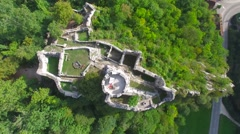 REVERSE OVERHEAD TILT SHOT OF ANCIENT CASTLE RUINS IN SWITZERLAND Stock Footage