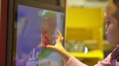 Girl draws on interactive whiteboard Stock Footage