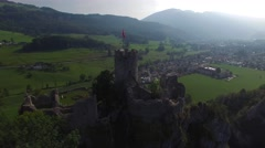 CINEMATIC AERIAL POINT OF INTEREST SHOT CASTLE OVERLOOKING CITY Stock Footage