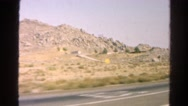 1966: desert and rugged mountain range as seen from moving vehicle CALIFORNIA Stock Footage