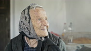 Old woman with a beautiful smile reminiscing Stock Footage