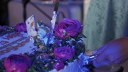 Woman take piece of cake with roses put on plate at celebration event Stock Footage