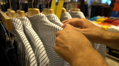 Male customer choosing office shirt at shopping mall Stock Footage
