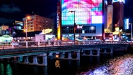 Fukuoka - Night view of glowing city by the river with traffic on the bridge. 4K Stock Footage