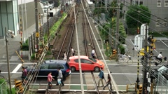 Tokyo - People and traffic at small railway crossing. 4K resolution. Shinjuku Stock Footage
