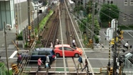 Tokyo - People and traffic at small railway crossing. 4K resolution. Shinjuku Stock Footage