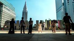 Tokyo - Time lapse of people in front of Shinjuku sign at JR Shinjuku station Stock Footage