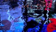 Osaka - Famous Glico running man billboard reflecting in water at night. 4K Stock Footage
