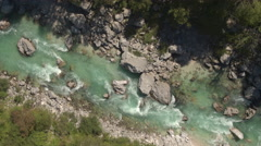 AERIAL: Astonishingly beautiful rocky riverbed of emerald maintain river Soca Stock Footage