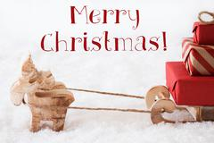 Reindeer With Sled On Snow, Text Merry Christmas Stock Photos