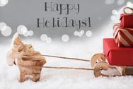 Reindeer With Sled, Silver Background, Text Happy Holidays Stock Photos