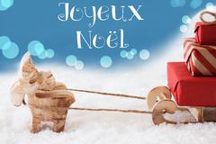 Reindeer, Sled, Light Blue Background, Joyeux Noel Means Merry Christmas Stock Photos