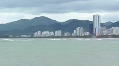 Nha Trang Cityscape over a Tropical Beach on a Cloudy Day Stock Footage