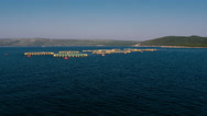 Aerial - Approaching circular cages for fish farming in the Adriatic Sea Stock Footage