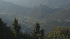 AERIAL: Beautiful river winding through mountain valley in misty morning Stock Footage
