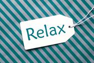 Label On Turquoise Wrapping Paper, Text Relax Stock Photos