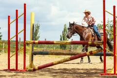 Western cowgirl woman training riding horse. Sport Stock Photos