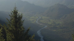 AERIAL: Mountain river running through beautiful green valley in sunny evening Stock Footage