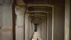 Perspective of Ancient Stone Columns at Angkor Wat in Cambodia Stock Footage