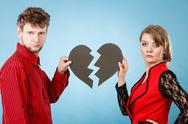 Couple with broken heart breaking up. Stock Photos