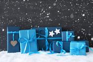 Blue Christmas Gifts, Black Cement Wall, Snow, Snowflakes Stock Photos