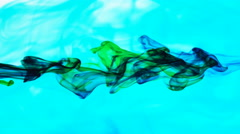 Color Ink flowing in water on blue background Stock Footage