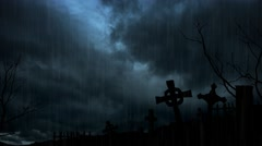 Spooky Headstones Silhouetted against a Stormy Night Sky Stock Footage