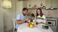 Couple eating breakfast muffins with coffee Stock Footage