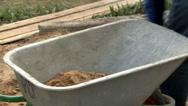 Manual wheelbarrow with concrete Stock Footage