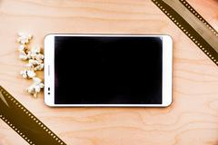 Tablet pc on wood with attributes of cinema Stock Photos