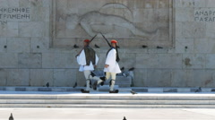 Guards in white cross in front of the tomb at parliament in athens, greece Stock Footage