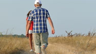 Slow motion. Adult  loving couple embraces on sea background.  Stock Footage