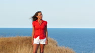 Slow motion. Adult  woman in red  and sea    Stock Footage