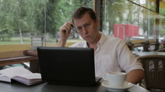 Man looking for the right idea, and suddenly the inspiration comes to him. He is Stock Footage