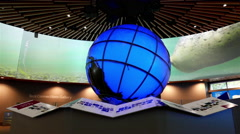 Motion of big screen and globe inside Vancouver aquarium Stock Footage