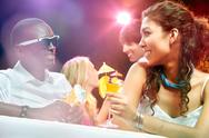 Two young people drinking martini and talking at club Stock Photos