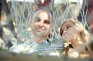 Young couple relaxing in hammock Stock Photos
