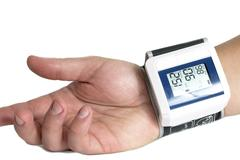 Tonometer on the patient's arm, a device for measuring blood pressure white b Stock Photos