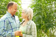 Mature couple in garden looking at each other Stock Photos