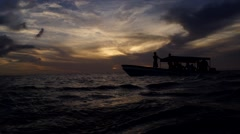 Boat in sea at sunset Stock Footage