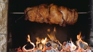 Chicken roasting on a spit Stock Footage